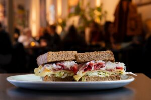 sourdough sandwich with hummus spread